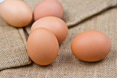 Eggs. Chicken eggs on jute background Stock Photo