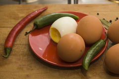 Eggs with chilli peppers for salad Stock Photo
