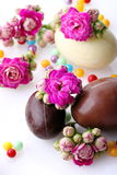 Eggs of chocolate with flowers Stock Photography