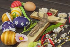 Eggs Christian Easter symbol. Preparation for Easter celebrations. Wooden cross with Christ. Stock Images