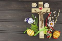 Eggs Christian Easter symbol. Preparation for Easter celebrations. Wooden cross with Christ. Stock Photography