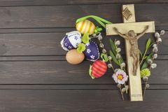 Eggs Christian Easter symbol. Preparation for Easter celebrations. Wooden cross with Christ. Royalty Free Stock Image