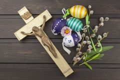 Eggs Christian Easter symbol. Preparation for Easter celebrations. Wooden cross with Christ. Stock Photos