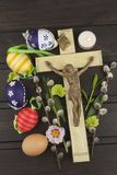 Eggs Christian Easter symbol. Preparation for Easter celebrations. Wooden cross with Christ. Resurrection, celebration of the coming of the savior. Painted Royalty Free Stock Photo