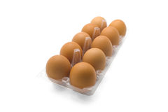 Eggs in clear plastic tray Stock Photo