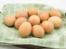 Eggs with cloth in basket Royalty Free Stock Photo