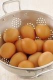 Eggs in a colander Royalty Free Stock Photos