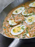 Eggs Cooked Moghali Style in a pan Royalty Free Stock Image