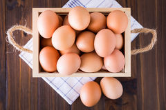 Eggs in crate Stock Photo
