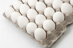 Eggs on crates Stock Images