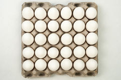 Eggs on crates Stock Photo