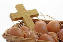 Eggs and Cross in a Basket Royalty Free Stock Photos