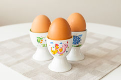 Eggs in cup holders Royalty Free Stock Images