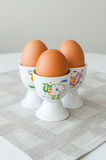 Eggs in cups Stock Images