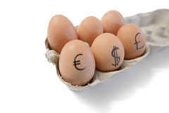 Eggs with currency symbols on it Stock Photos
