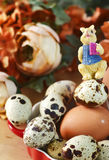 Eggs with decorative bunny over flowers background Stock Photos