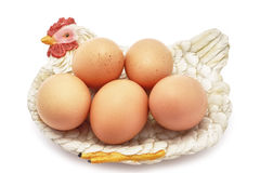 Eggs on decorative hen nest Stock Images