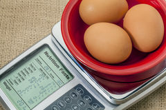 Eggs on diet scale Royalty Free Stock Photos