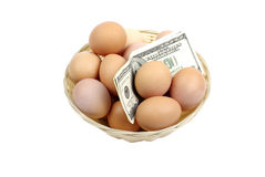 Eggs with dollars. Royalty Free Stock Image