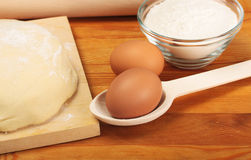 Eggs, dough, flour Stock Image