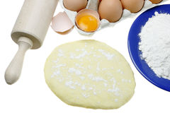 Eggs,dough and rolling pin Stock Images