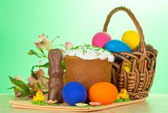 Eggs, an Easter cake, rabbit and alstromeria Royalty Free Stock Photography