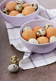 Eggs by Easter in a ceramic bowl. On a checkered linen napkin Royalty Free Stock Photos