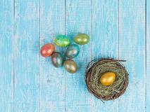 Eggs for Easter. Decorated eggs for Easter on the background in the style of Provence. Nest with golden egg Stock Images
