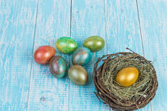 Eggs for Easter. Decorated eggs for Easter on the background in the style of Provence. Nest with golden egg Stock Image