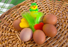 Eggs with easter decoration and felt hearts on wicker tray. Royalty Free Stock Image