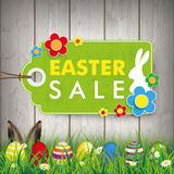 Eggs Easter Sale Price Sticker Wood Grass. Green grass with colored easter eggs and price stickers for easter sale Stock Photos