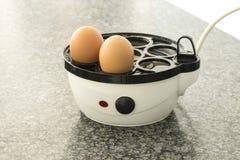 Eggs in an egg boiler Stock Photo