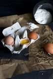 Eggs in a egg carton. Close-up shot of eggs on a brown paper. Food styling stock photography