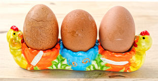 Eggs in the egg cup Stock Photos