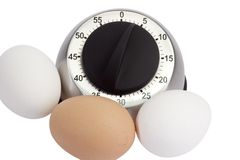 Eggs with Egg Timer Royalty Free Stock Photo