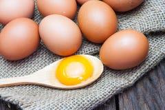 Eggs and egg yolks. On sack stock photos