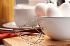 Eggs and eggbeater Stock Images