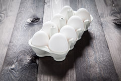 Eggs in a eggbox. On a black wooden table Royalty Free Stock Images