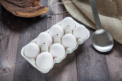 Eggs in a eggbox. On a black wooden table Stock Photography