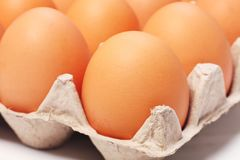 Eggs. In a paper package on white background Royalty Free Stock Photography