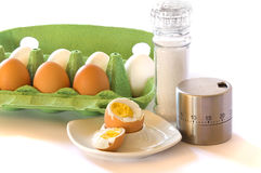 Eggs and eggtimer Royalty Free Stock Photography