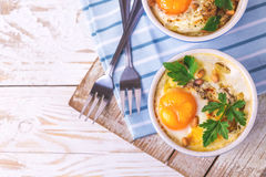 Eggs en Cocotte baked with spinach, parsley and cream Stock Images