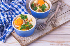 Eggs en Cocotte baked with spinach, parsley and cream Royalty Free Stock Images