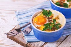 Eggs en Cocotte baked with spinach, parsley and cream Royalty Free Stock Image