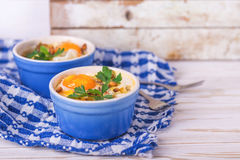 Eggs en Cocotte baked with spinach, parsley and cream Royalty Free Stock Photo