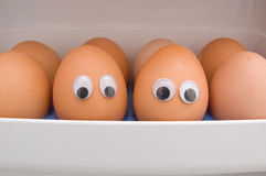 Eggs with eyes. On the refrigerator Royalty Free Stock Images