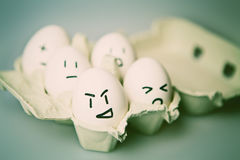 Eggs with Faces Stock Photography