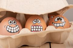 Eggs with faces. Close up of Eggs with faces stock photography