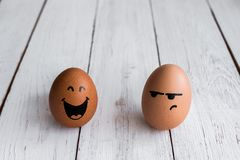 Eggs Faces, drawnigs on egg stock photo