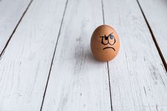 Eggs Faces, drawnigs on egg, mad face royalty free stock images